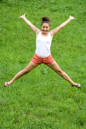 Girl doing exercises in park Stock Photo - 10021254