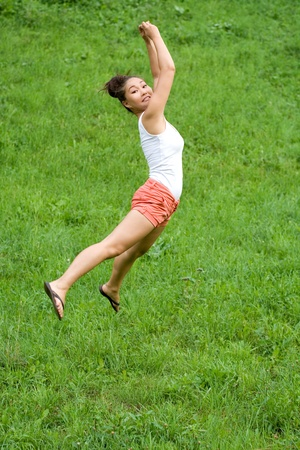 Girl doing exercises in park photo