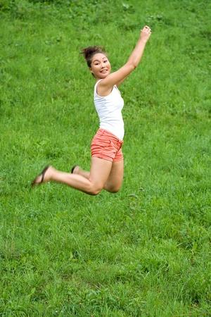 Girl doing exercises in park Stock Photo - 10081889