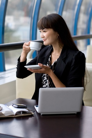Businesswoman having a cup of tea photo