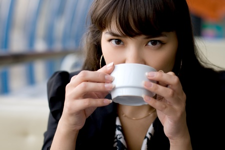 Businesswoman drinking tea in a cafe photo
