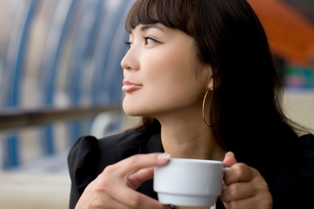 sexy office girl: Businesswoman drinking tea in a cafe Stock Photo