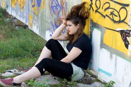 nonconformity: Punk girl walking outdoor