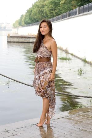 Beautiful girl walking near river Stock Photo - 10660036