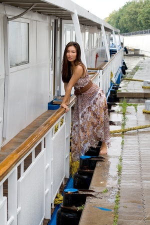 Beautiful girl walking near river Stock Photo - 10660074