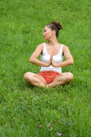 Girl meditating in park photo