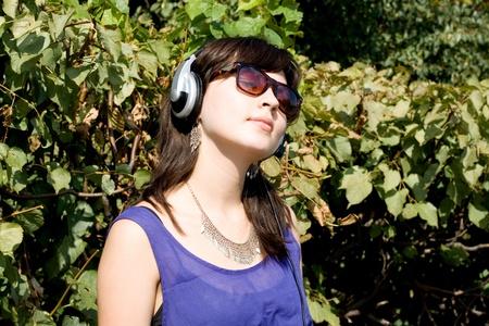 Girl listening music in headphones photo