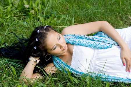 Beautiful pregnant girl lying on grass photo