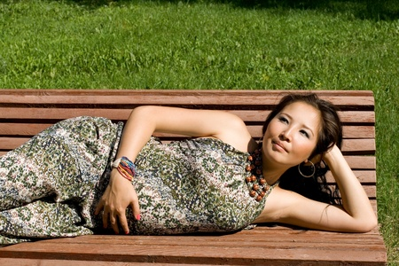 Beautiful pregnant girl lying on bench photo