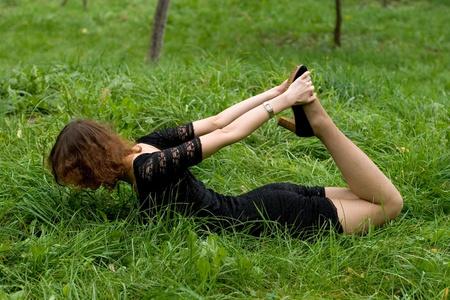 plasticity: Sexy girl lying on grass
