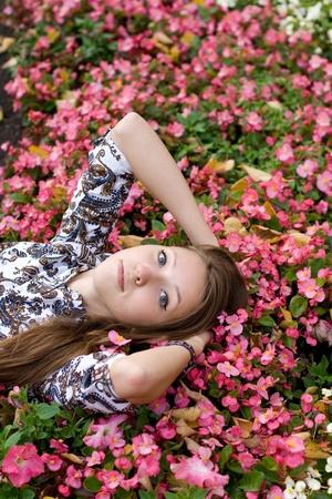 Beautiful girl lying among flowers  Stock Photo