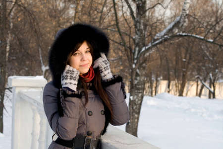 Portrait of a girl walking in park in winter photo