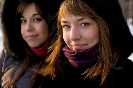 Two female friends walking in park in winter Stock Photo - 12499896