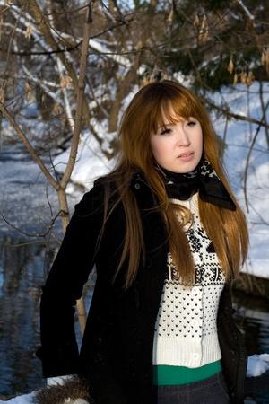 Portrait of a girl walking in park in winter photo