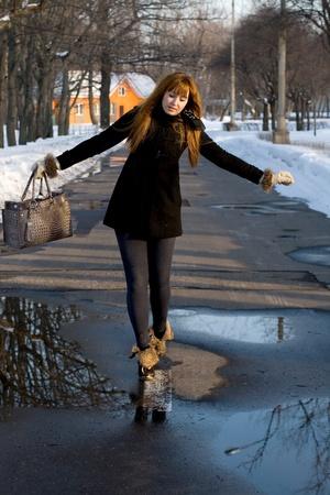 demarcation: Portrait of a girl walking in park in winter