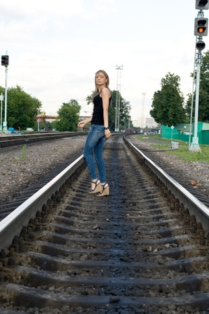 Girl traveling by railroad photo