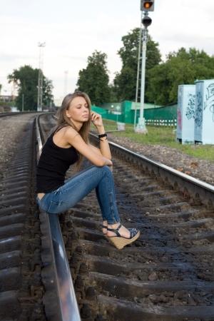 Girl sitting on rails photo
