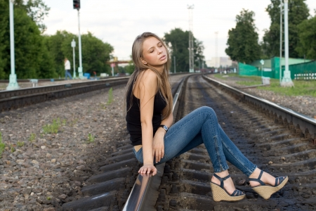 Girl sitting on rails photo
