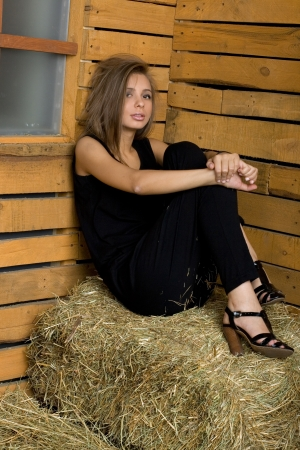 hayloft: Girl sitting on hay