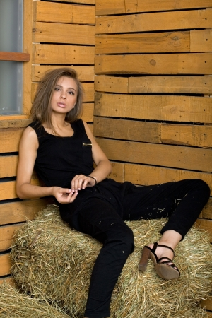 Girl sitting on hay photo