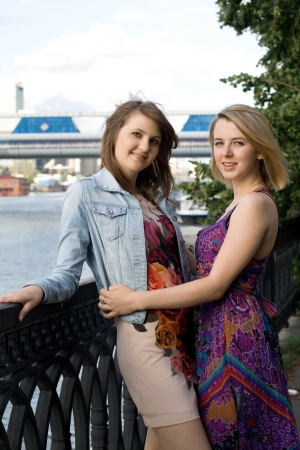 Two female friends walking outdoor Stock Photo