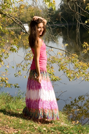 long lake: Beautiful girl in forest near pond