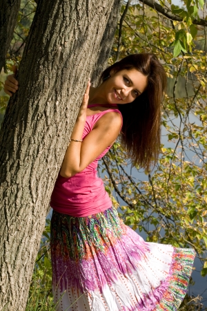 Beautiful girl in forest near pond photo