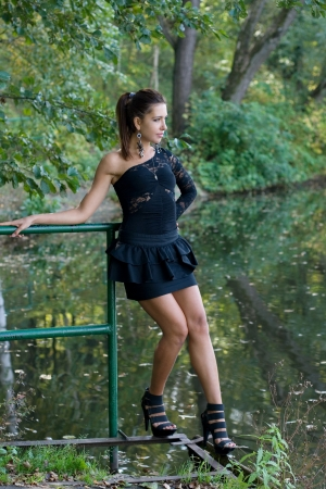 Beautiful girl in forest near pond