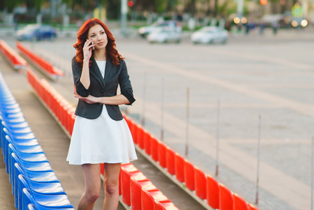 mobile app: Business woman talking on the phone