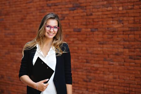 Business woman portrait with folder