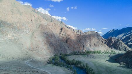 river flows along the mountains in Mongolia 写真素材 - 132231511
