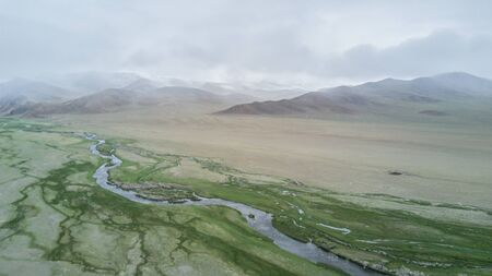river flows along the mountains in Mongolia 写真素材 - 132231473