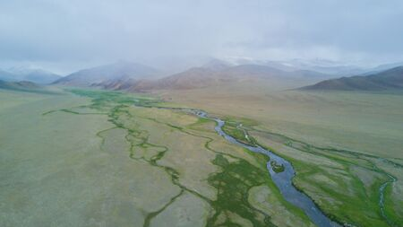 river flows along the mountains in Mongolia 写真素材 - 132230833