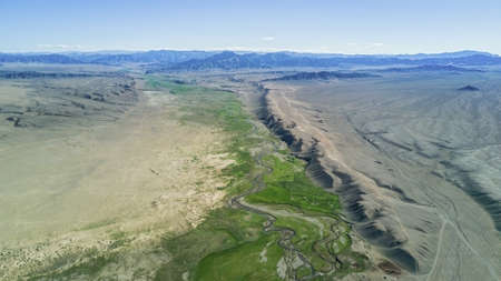 river flows along the mountains in Mongolia