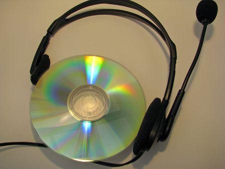 audio: audio CD disc with earphones on Stock Photo