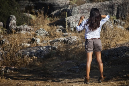 Young girl dressed adventurer posing in nature photo