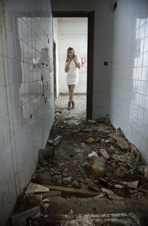Sexy girl with expression of fear in abandoned building Stock Photo - 10871274