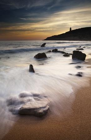 Rocky beach at sunset Stock Photo - 11753477