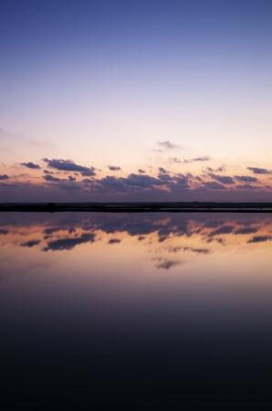 salt marsh: Sunset reflecting clouds in the salt Bacuta, Odiel Natural Park in Huelva (Spain)