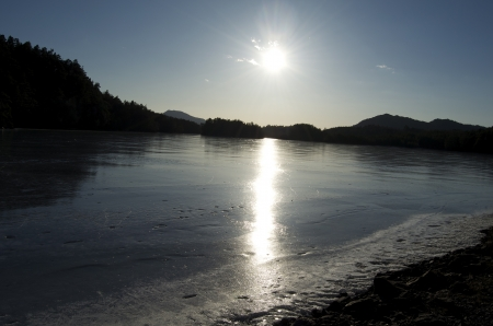 Sunplay on a frozen forest lake surface Stock Photo - 18821847