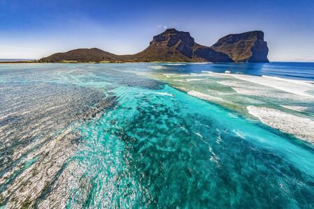 Aerial view of Lord Howe Island Coasts, turquoise blue Coral reef lagoon, the Tasman Sea, between Australia and New Zealand
