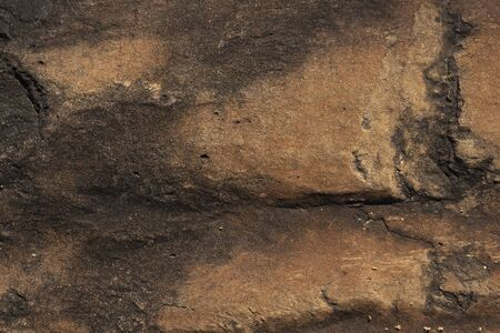 close up of brown and orange stone rock formation texture background
