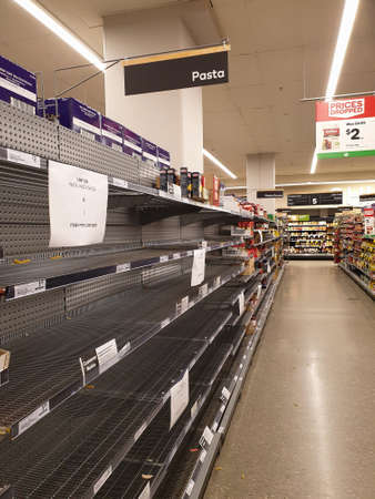 Gold Coast, Australia - March 21, 2020: Woolworths supermarket empty pasta and sauce shelves amid coronavirus fears, shoppers panic buying and stockpiling pasta as Australia prepares for a pandemic.