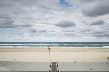 Surfers Paradise beach closed, covid-19 virus, beach closed or shutdown concept amid coronavirus fears Stock Photo
