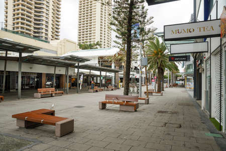 Surfers Paradise, Australia - April 8, 2020: coronavirus lockdown empty streets of iconic cavill ave mall in Surfers Paradise, covid 19 causes businesses to shutdown or close in pandemic on gold coast