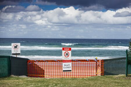 beach closed coronavirus sign, beach closed or shutdown concept amid covid 19 fears and panic over contagious virus spread, 2019-ncov forces international governments to lockdown beaches worldwide