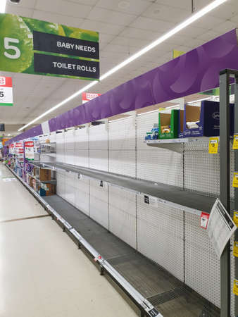 Gold Coast, Australia - March 9, 2020: Supermarket empty toilet paper shelves amid coronavirus fears, shoppers panic buying and stockpiling toilet paper preparing for a covid 19 pandemic Editorial