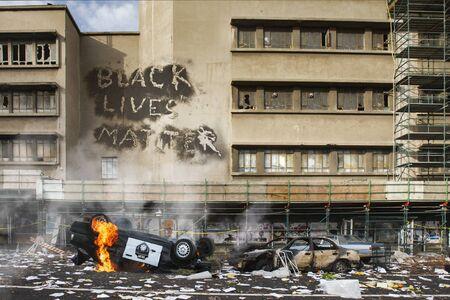 Black Lives Matter protest riot vandalism, looting aftermath concept, flaming police car smashed, overturned with black lives matter text slogan message on building. Excessive force, police brutality