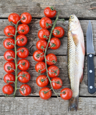 raw mullet with cherry tomatoes  photo