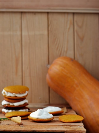 pumpkin whoopie cookie on the autumn background Stock Photo - 18939526